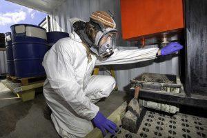 A worker in a hazardous materials factory